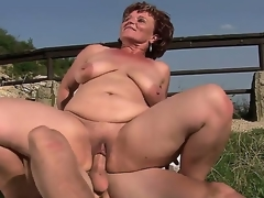 Older bbw Manyika with bald fur pie bonking with young boyfriend at the open air