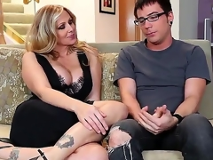 Dane Cross and chubby breasted cougar Julia Ann are having some admirable time on the ottoman and they look very pretty and rather horny in many ways.