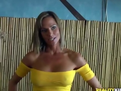Shes a gorgeous MILF with big fake tits and slim figure. Leggy well stacked woman in yellow blouse and blue skin tight jeans turns stud on. MILF Hunter cant resist! She is devilishly sexy