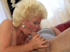Effie is a blond-haired aged slut with fuckable titties. This babe strokes juvenile hard dick with her nice juggs and then takes it in her mouth. This babe shows her hairy mature pussy while doing it