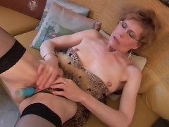 Mature in stockings and lingerie has dildo sex