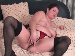 Fat mature in stockings and pants masturbates