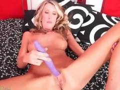 Masturbating golden-haired mommy with big fake scones