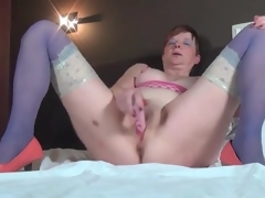 Masturbating older sweetheart in blue stockings
