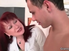 Older artist gives her young nude model a tugjob