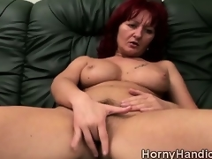 Filthy redhead MILF with huge boobs goes lustful on the couch