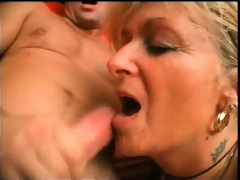 Horny blonde older slut widens her legs and gets her wet