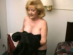 Lustful golden-haired grandma Kitty Fox stripping and showing her hawt decolletage