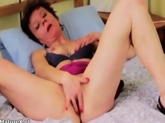Mature milf is without equal on will not hear of bed and masturbating