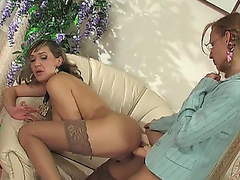 Kinky aged chick in smooth nylons treating breathtaking honey with strap-on